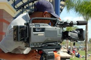 News cameraman begins filming.