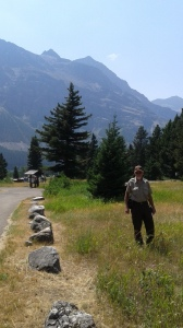 Alan Deegan stands in grass in front of mountain.