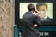 Man talks to video image