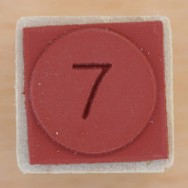 Red tile with number seven