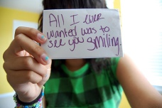 "Note that reads: ""All I ever wanted was to see you smiling."""
