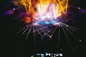 Many bright lights extend from a large stage.