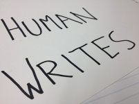 Human Writes with a W is written on paper with a marker.