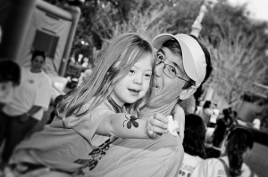 Father holds daughter who has Down Syndrome.