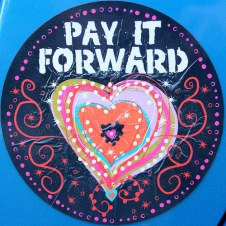 Heart circle that reads Pay It Forward.