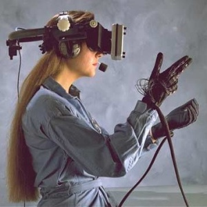 Woman wears virtual reality visual headset and holds hand controls to control what she does during the event.