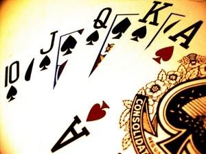 Royal Flush poker hand with cards 10, Jack, Queen, King, and Ace.