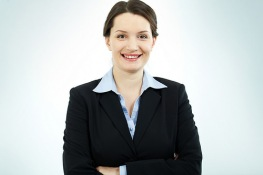 Woman wearing business suit and smiling.