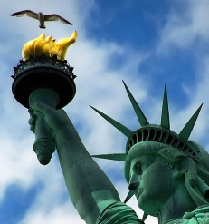 Statue of Liberty holds up torch and seagull flies overhead
