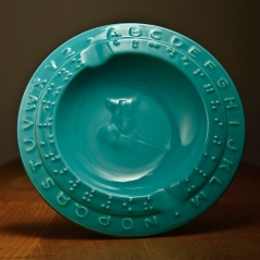 Children's bowl with Braille and upraised letters.
