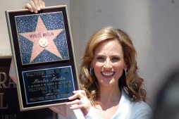 Marlee Matlin holds us plaque of her Hollywood star.