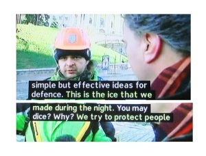 Captions show road worker talking about ice and dice.