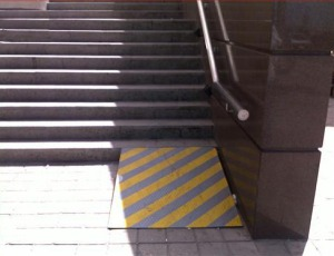 Wheelchair ramp leads up to steps