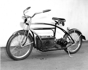 Old picture of a bicycle with a gas tank and motor added to make it like a motorcycle.