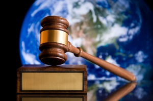 Gavel above picture of planet Earth