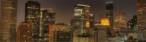 Houston skyline at night shows many skyscrapers.