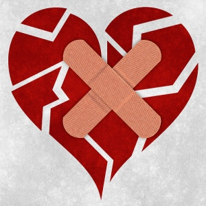 Broken heart with two Bandaids across it