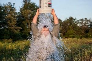 man dumps ice bucket over his head
