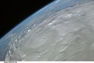 Hurricane as seen from a satellite in space: clouds spin in circles.