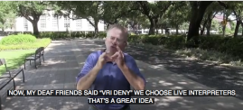 "Man uses sign language for interpreter and captions read: ""My friends said 'VRI Deny. We choose a live interpreter.' That's a great idea."""