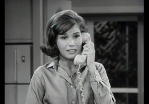 Black and white picture from a scene with Dick Van Dyke's wife on the telephone.