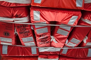 Many lifejackets are restrained by cords.