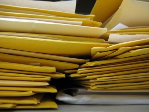 Stack of manila envelopes.