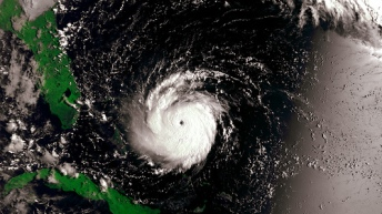 Picture of a swirling hurricane in the ocean heading toward Florida.