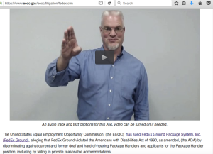 Picture shows a screen shot of someone using sign language in an ASL video on the EEOC website.