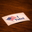 Sticker has American flag and says I voted.
