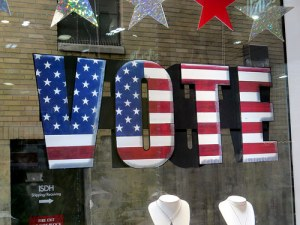Sign with American flag design that says VOTE
