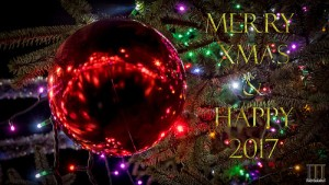 Merry Xmas and Happy New Year 2017 words over picture of Christmas tree and big red ornament.