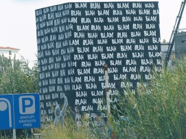 Big sign reads blah, blah, blah perhaps 100 times.
