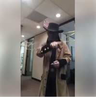 Sign Shares' Deaf Advocate, Marco Segovia in scary Halloween costume with hat and shroud over his face.