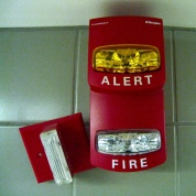 Picture of a professional quality alarm clock with flashing light fire alerts.