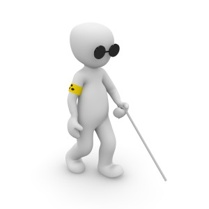 A three-dimensional white figure wears glasses, walks with a white cane, and has a yellow arm band with three black dots.