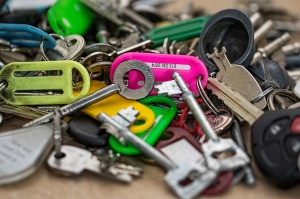A pile of keys of different sizes and colors