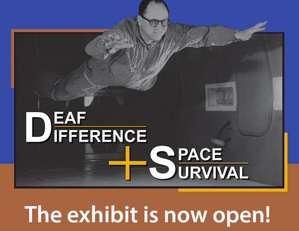 Man floats anti-gravity and sign says, Deaf Difference + Space Survival ... the exhibit is now open