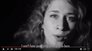 Woman sings I won't hear you crying when you're born (captions)